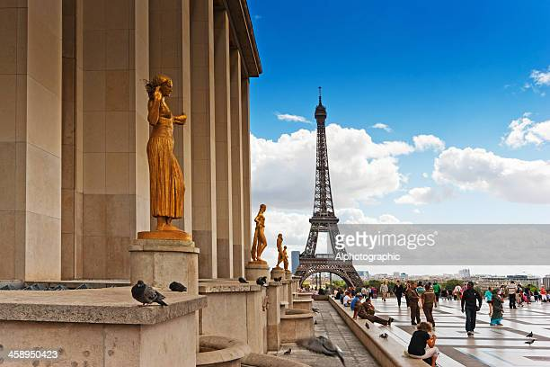 Golden statues and Eiffel tower in the background