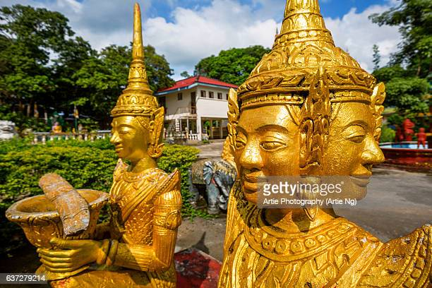golden statues at wat krom (lower wat), sihanoukville, cambodia - wat stock pictures, royalty-free photos & images