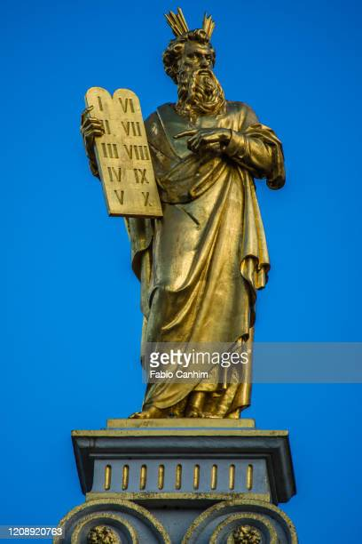 golden statues of moses on top of medieval palace of justice (oude griffie) in bruges. - supreme court justice stock pictures, royalty-free photos & images