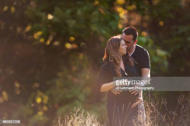 Golden Sun Drenched Maternity Session of Expectant Mother and Father of Twins