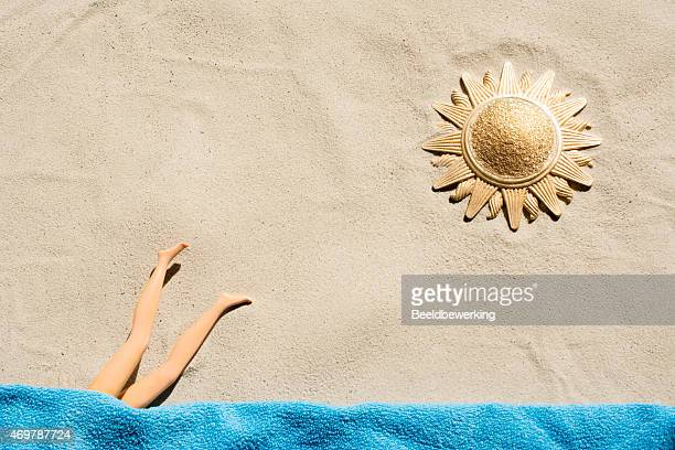 Golden sun fashion doll diving   towel on the  beach