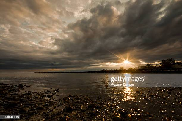 golden sun on black sky - westport connecticut stock photos and pictures