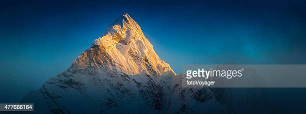 golden sunlight illuminating snowy mountain peak ama dablam himalayas nepal - rock formation stock photos and pictures