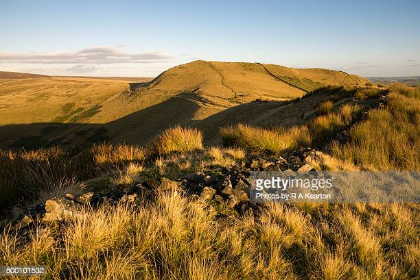 Golden sunlight on moors above Hayfield in the Peak District, England