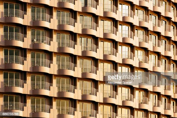 Golden sunlight reflecting in multiple windows of a residential high rise building