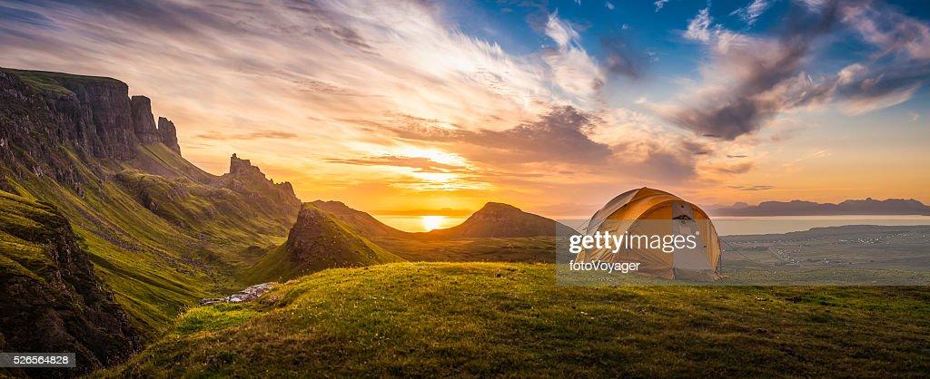 Golden sunrise illuminating tent camping dramatic mountain landscape panorama Scotland : Stock Photo