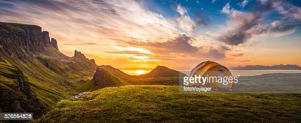 golden sunrise illuminating tent camping dramatic mountain landscape panorama scotland - panoramic stock pictures, royalty-free photos & images