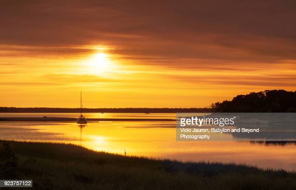 golden sunrise on the north shore of long island - sag harbor stock photos and pictures