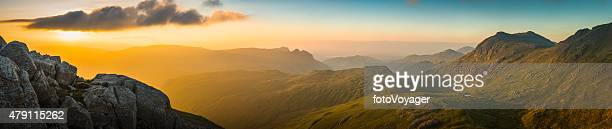 Golden sunrise over mountain peaks panorama Langdale Pikes Lake District