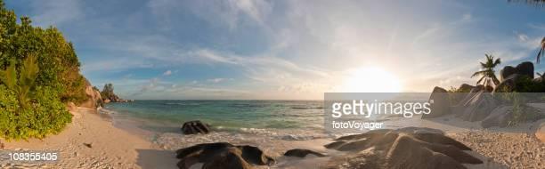 golden sunset idyllic desert island beach palm trees surf panorama - lagoon stock pictures, royalty-free photos & images