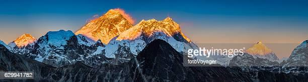 Golden sunset on Mt Everest summit Himalaya mountains peaks panorama