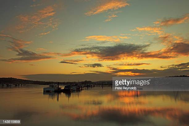 golden sunset on river medway - river medway stock photos and pictures