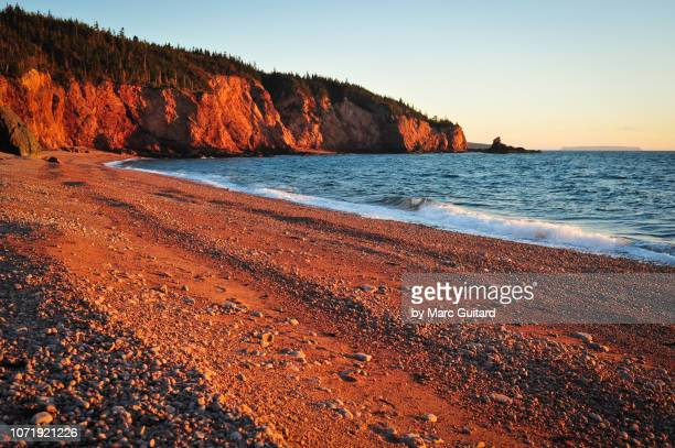 golden sunset on rocky beach, cape chignecto provincial park, nova scotia, canada - east stock pictures, royalty-free photos & images