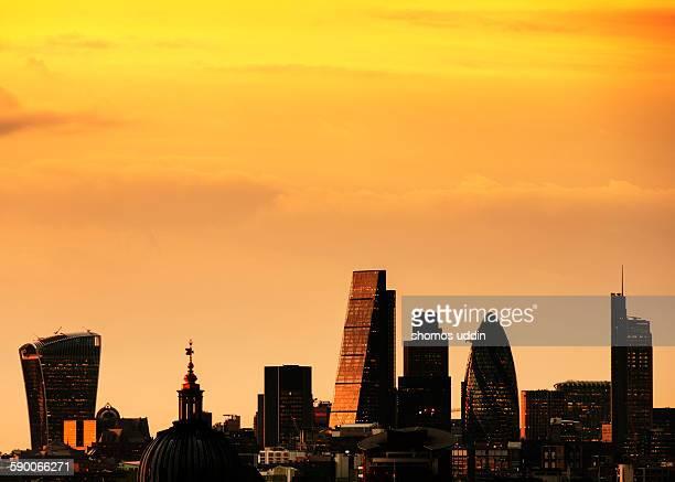 Golden sunset over city skyline