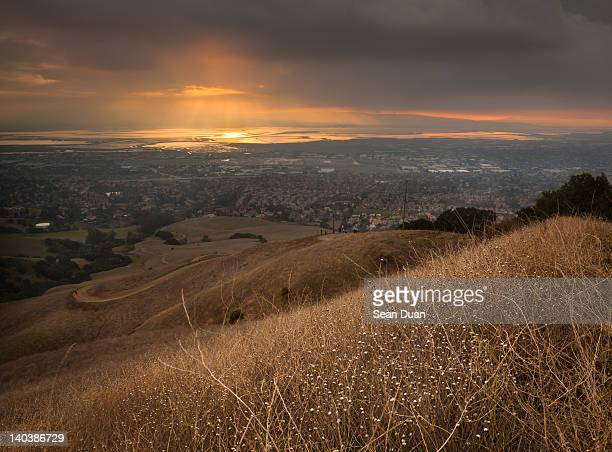 golden sunset over san francisco bay - mission district stock photos and pictures