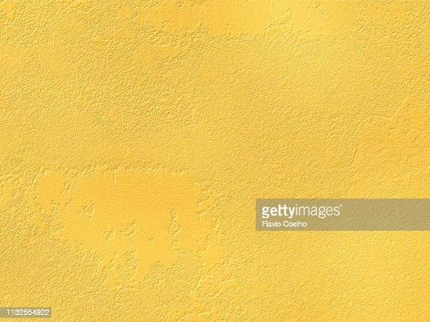 golden surface texture background - grainy stock pictures, royalty-free photos & images