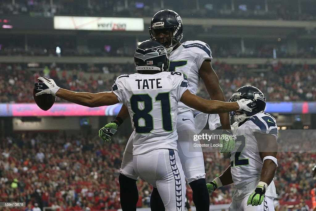Golden Tate #81 celebrates his third quarter touchdown with Anthony McCoy #85 of the Seattle Seahawks during the NFC Divisional Playoff Game against the Atlanta Falcons at Georgia Dome on January 13, 2013 in Atlanta, Georgia.