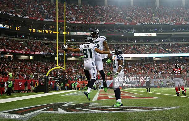 Golden Tate celebrates his third quarter touchdown with Anthony McCoy of the Seattle Seahawks during the NFC Divisional Playoff Game against the...