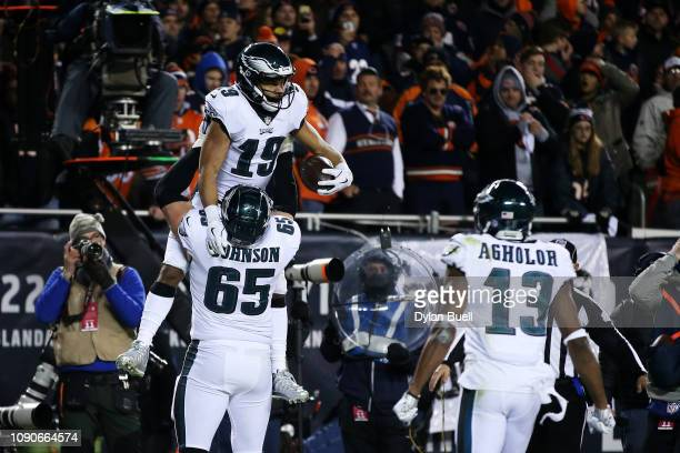 Golden Tate celebrates with Lane Johnson of the Philadelphia Eagles after scoring a touchdown against the Chicago Bears in the fourth quarter of the...