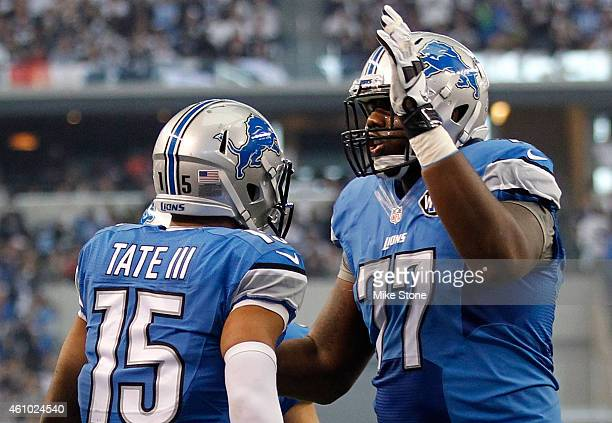 Golden Tate of the Detroit Lions and Cornelius Lucas of the Detroit Lions celebrate Tate's touchdown against the Dallas Cowboys during the first half...