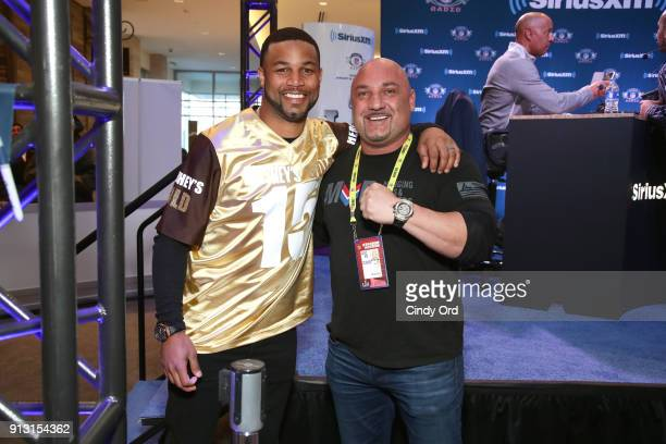 Golden Tate of the Detroit Lions and sportswriter Jay Glazer attend SiriusXM at Super Bowl LII Radio Row at the Mall of America on February 1 2018 in...