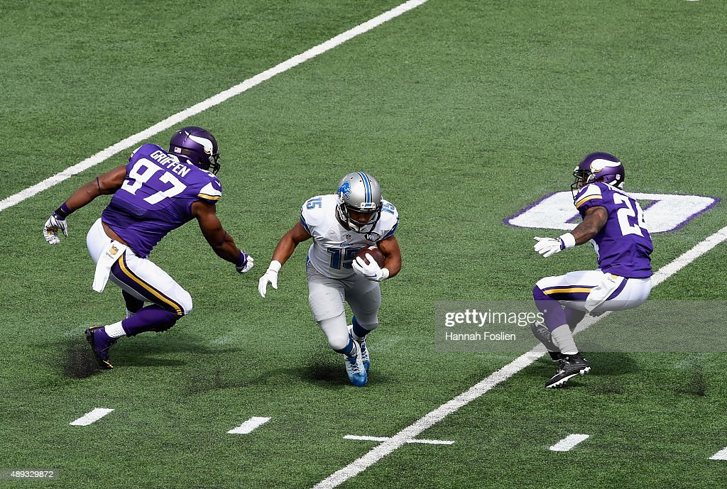 Golden Tate #15 of the Detroit Lions carries the ball against Everson Griffen #97 and Captain Munnerlyn #24 of the Minnesota Vikings during the first quarter of the game on September 20, 2015 at TCF Bank Stadium in Minneapolis, Minnesota.