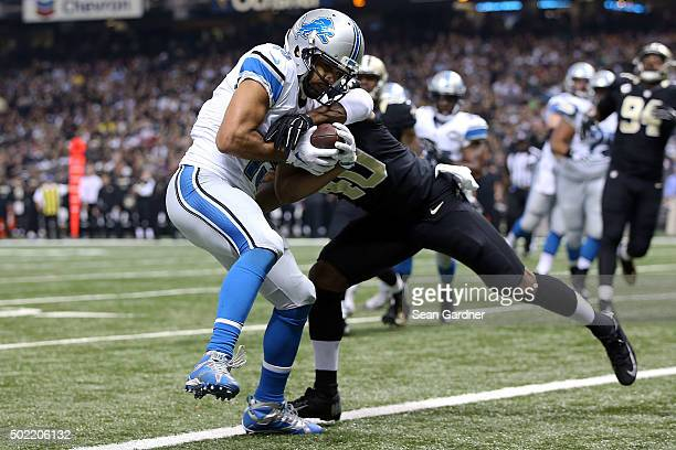 Golden Tate of the Detroit Lions catches a pass for a touchdown in front of Delvin Breaux of the New Orleans Saints during the first quarter of a...