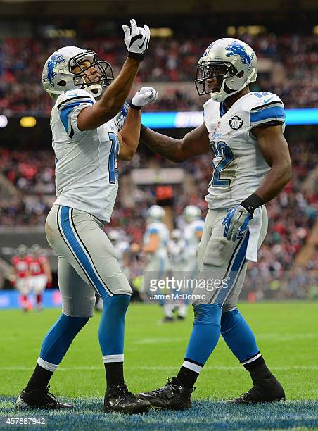 Golden Tate of the Detroit Lions celebrates scoring a touchdown in the third quarter with Jeremy Ross of the Detroit Lions during the NFL match...