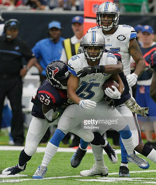 Golden Tate of the Detroit Lions is tackled by Andre Hal of the Houston Texans at NRG Stadium on October 30, 2016 in Houston, Texas.