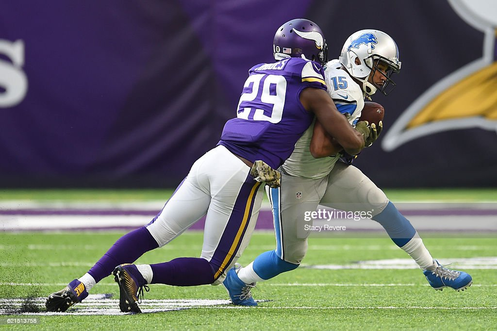 Golden Tate #15 of the Detroit Lions is tackled by Xavier Rhodes #29 of the Minnesota Vikings during overtime on November 6, 2016 at US Bank Stadium in Minneapolis, Minnesota.