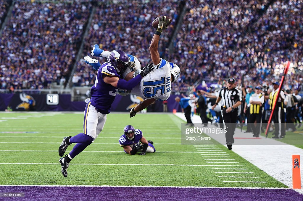 Golden Tate #15 of the Detroit Lions leaps into the end zone for the go ahead touchdown while being tackled by Andrew Sendejo #34 of the Minnesota Vikings during overtime on November 6, 2016 at US Bank Stadium in Minneapolis, Minnesota.