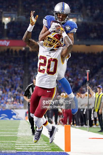 Golden Tate of the Detroit Lions makes a catch over the head of Greg Toler of the Washington Redskins but it was ruled incomplete because he came...