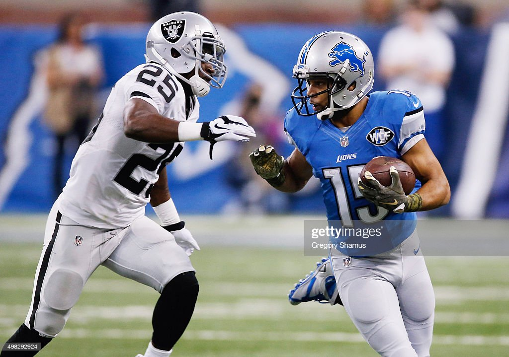 Golden Tate #15 of the Detroit Lions runs for a first down while being defended by D.J. Hayden #25 of the Oakland Raiders at Ford Field on November 22, 2015 in Detroit, Michigan.