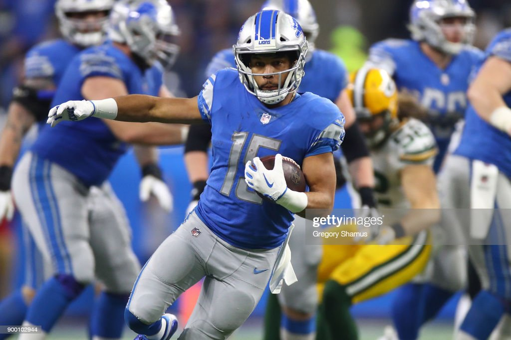 Golden Tate #15 of the Detroit Lions runs for yardage against the Green Bay Packers during the first half at Little Caesars Arena on December 29, 2017 in Detroit, Michigan.