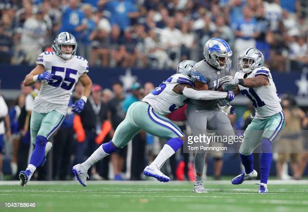 Golden Tate of the Detroit Lions runs the football against Leighton Vander Esch Kavon Frazier and Byron Jones of the Dallas Cowboys in the fourth...