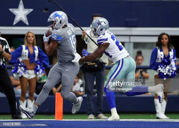 Golden Tate of the Detroit Lions scores a touchdown against Chidobe Awuzie of the Dallas Cowboys in the fourth quarter at ATT Stadium on September 30...