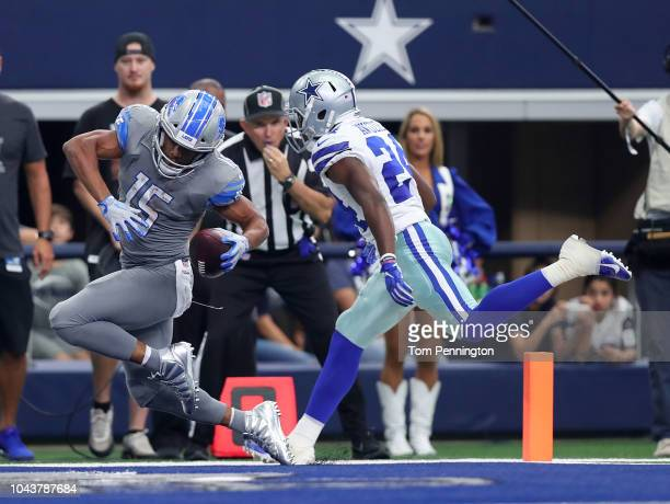 Golden Tate of the Detroit Lions scores a touchdown against Chidobe Awuzie of the Dallas Cowboys in the fourth quarter of a game at ATT Stadium on...
