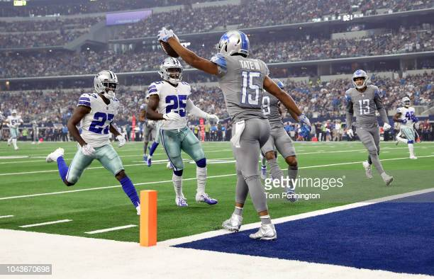 Golden Tate of the Detroit Lions scores a touchdown against Jourdan Lewis of the Dallas Cowboys and Xavier Woods of the Dallas Cowboys in the first...