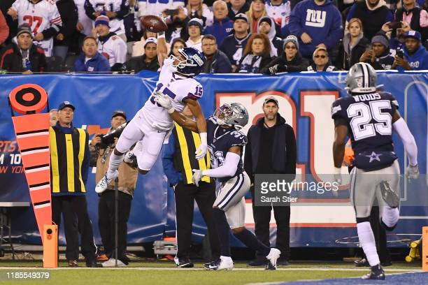 Golden Tate of the New York Giants leaps into the air for a catch to give the Giants some yardage during the second quarter of the game against the...