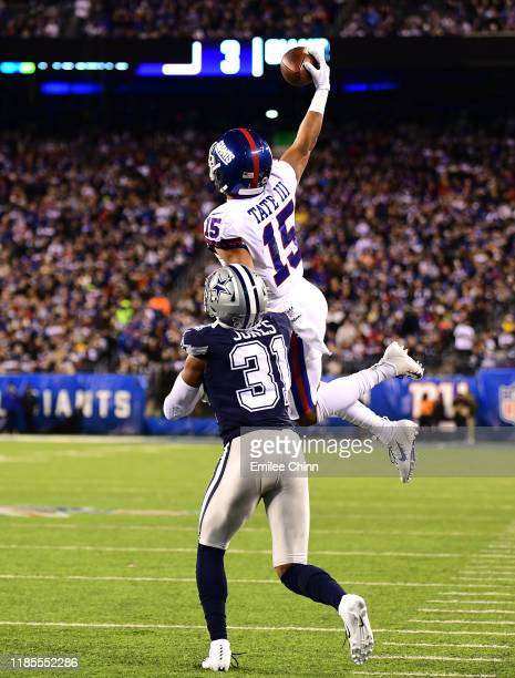 Golden Tate of the New York Giants makes a onehanded catch as Byron Jones of the Dallas Cowboys tries to tackle him during the second quarter of...