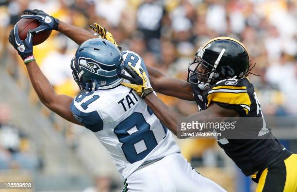 Golden Tate of the Seattle Seahawks catches a pass in front of William Gay of the Pittsburgh Steelers in the first half during the game on September...