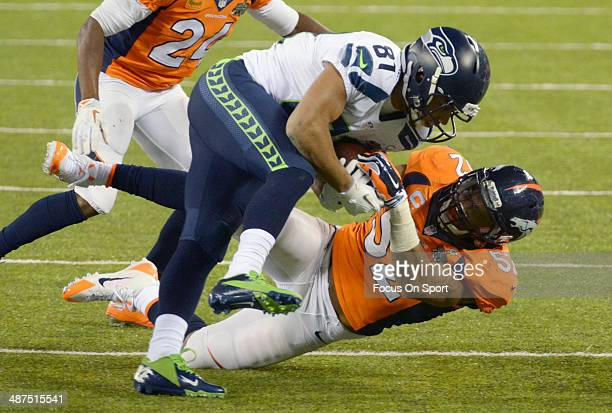 Golden Tate of the Seattle Seahawks gets tackled by Wesley Woodyard of the Denver Broncos during Super Bowl XLVIII on February 2 2014 at MetLife...