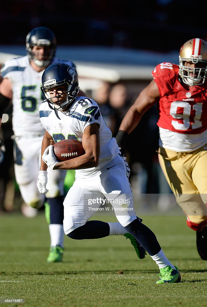 Golden Tate #81 of the Seattle Seahawks runs with the ball after a short pass catch against the San Francisco 49ers during the second quarter at Candlestick Park on December 8, 2013 in San Francisco, California.