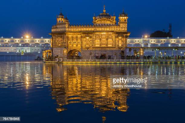 golden temple at sacred lake, amritsar, punjab, india - amritsar stock pictures, royalty-free photos & images