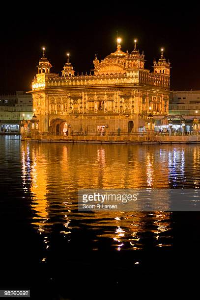 golden temple in amritsar at night - amritsar stock pictures, royalty-free photos & images