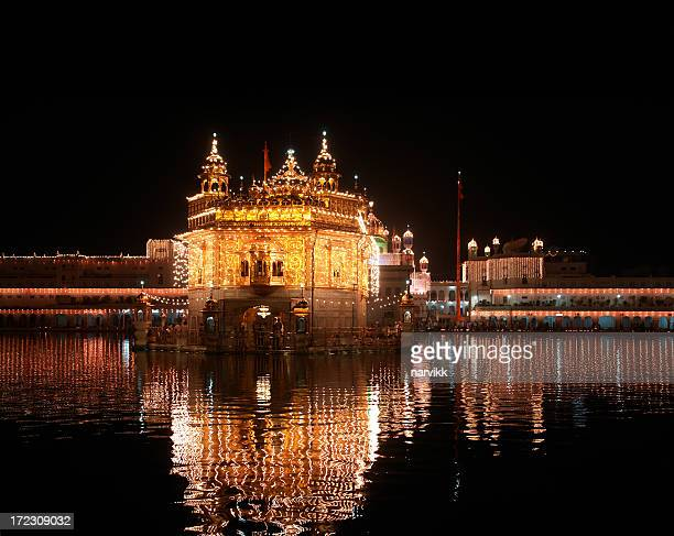 golden temple in amritsar, india - golden temple india stock photos and pictures