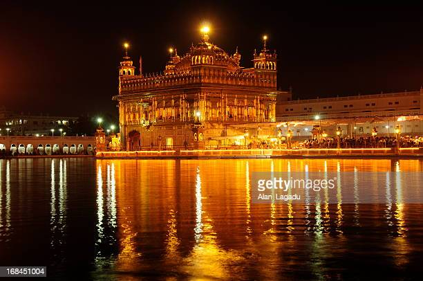 golden temple,amritsar,punjab,india. - golden temple india stock photos and pictures