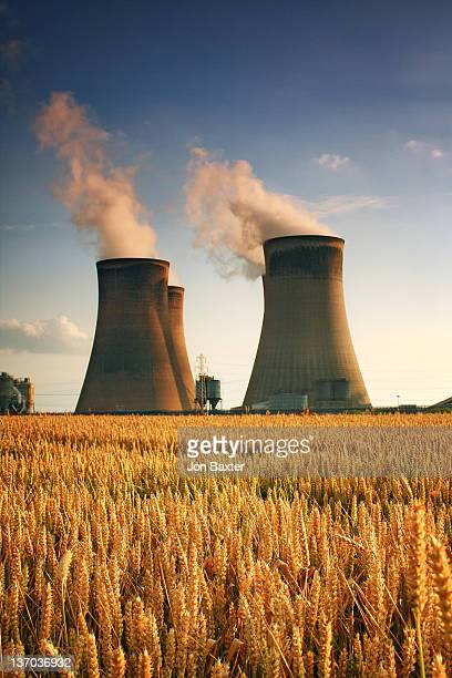 golden towers ..... - cooling tower stock pictures, royalty-free photos & images