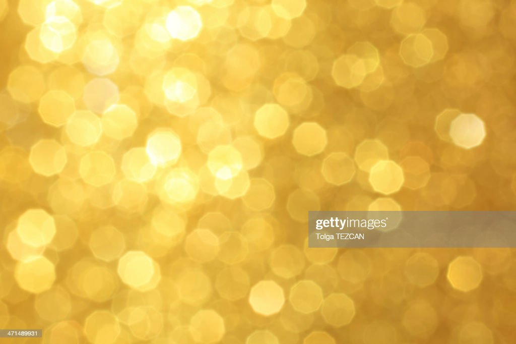 Golden unfocused light background : Stock Photo