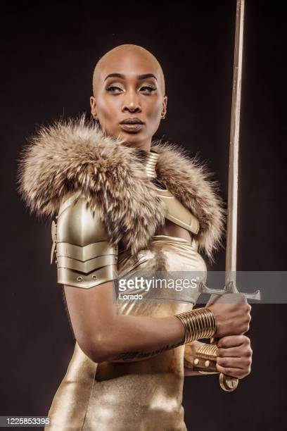 golden viking inspired warrior female in studio shot - traditional armor stock pictures, royalty-free photos & images